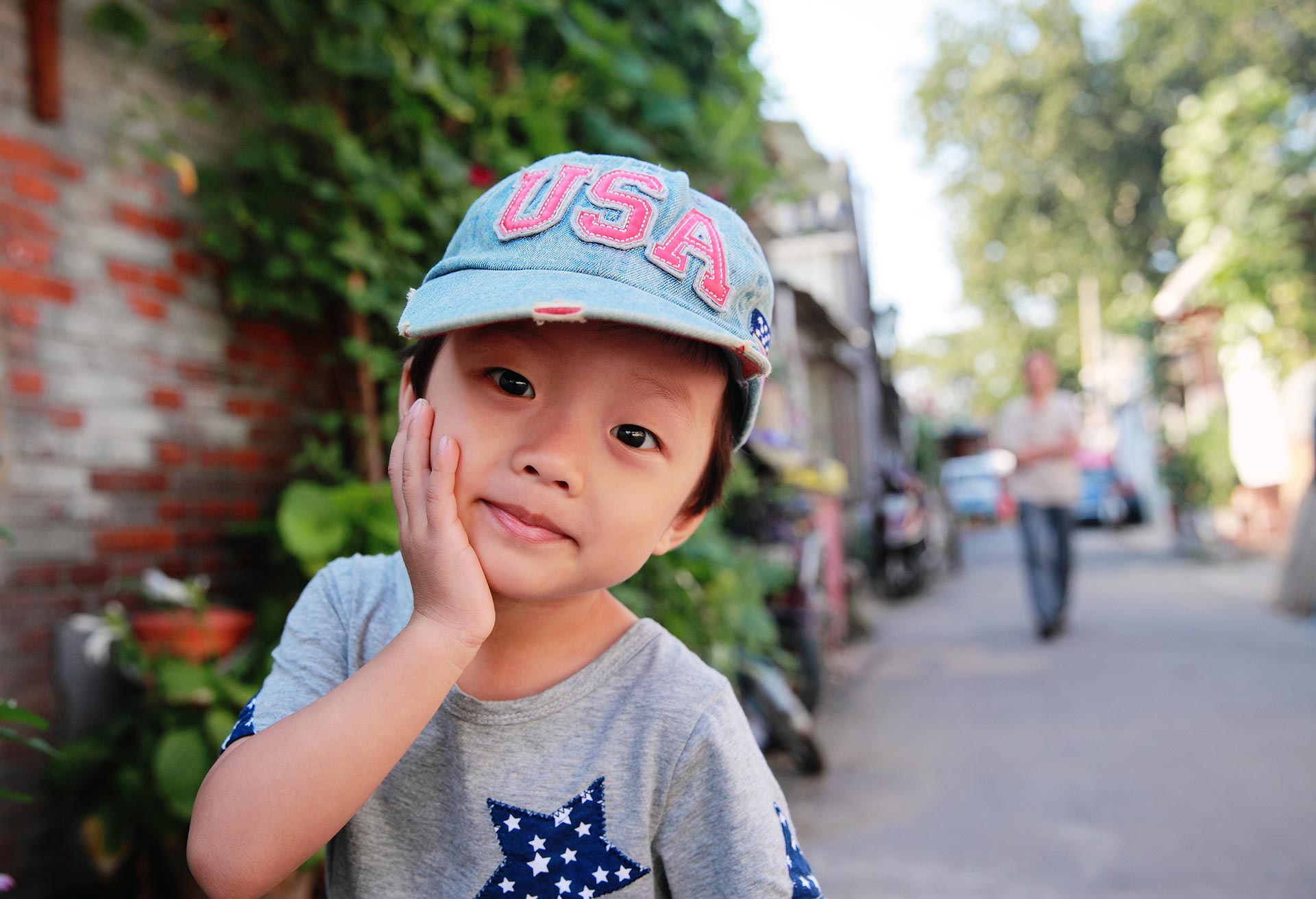 smiling child in U.S.A. hat