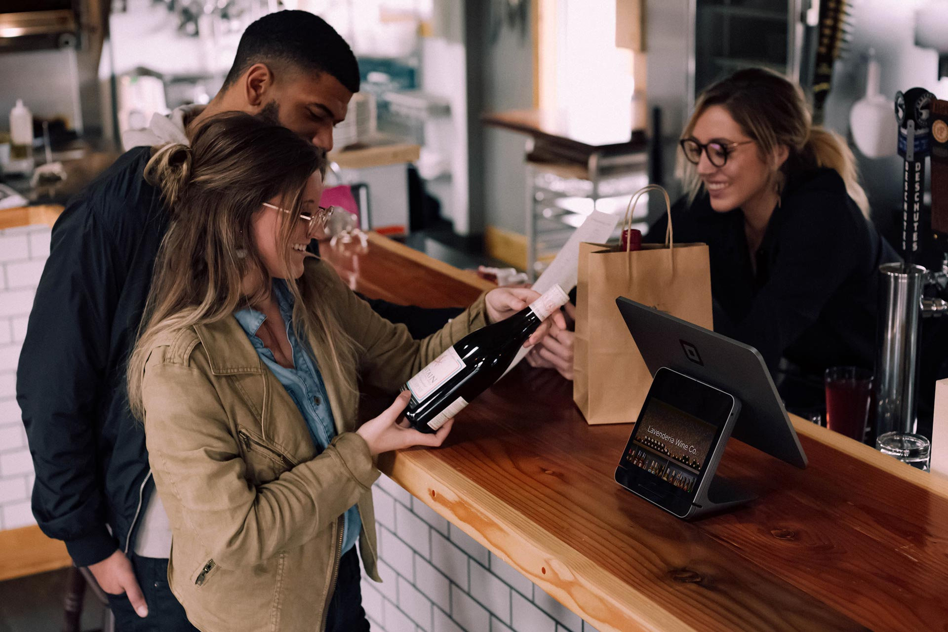 couple purchasing wine