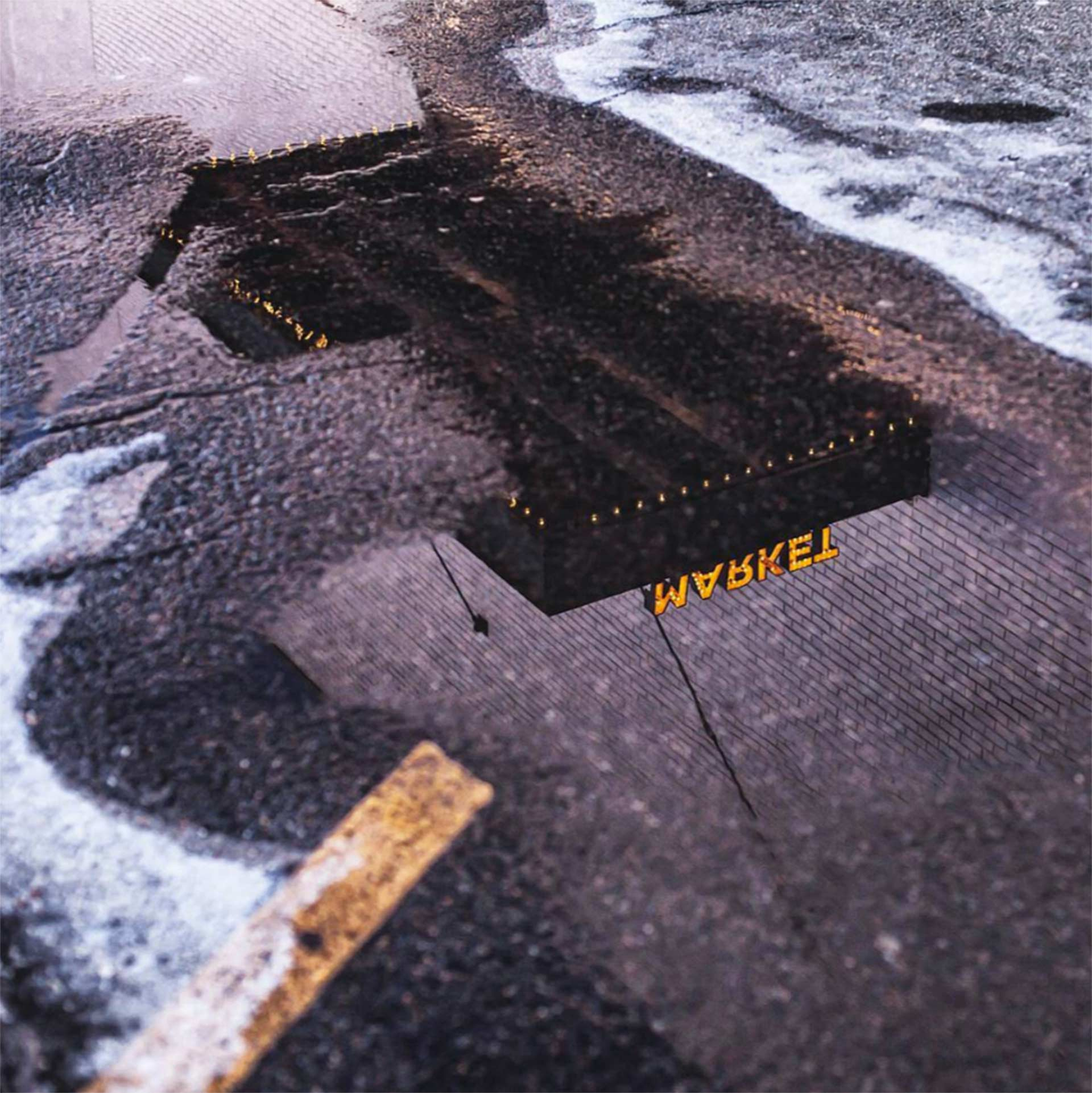 market sign reflected in puddle