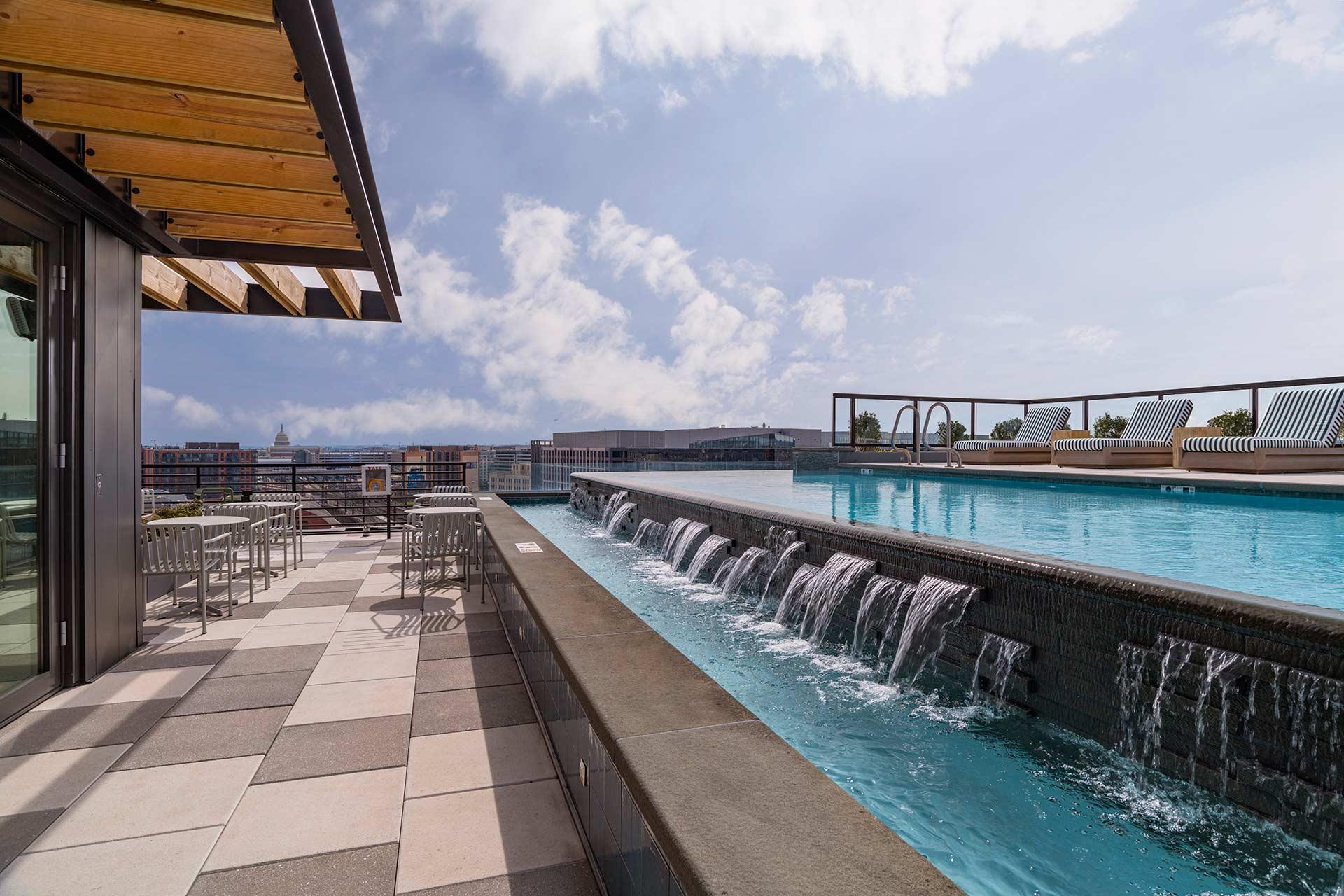 infinity pool with waterfall overlooking city