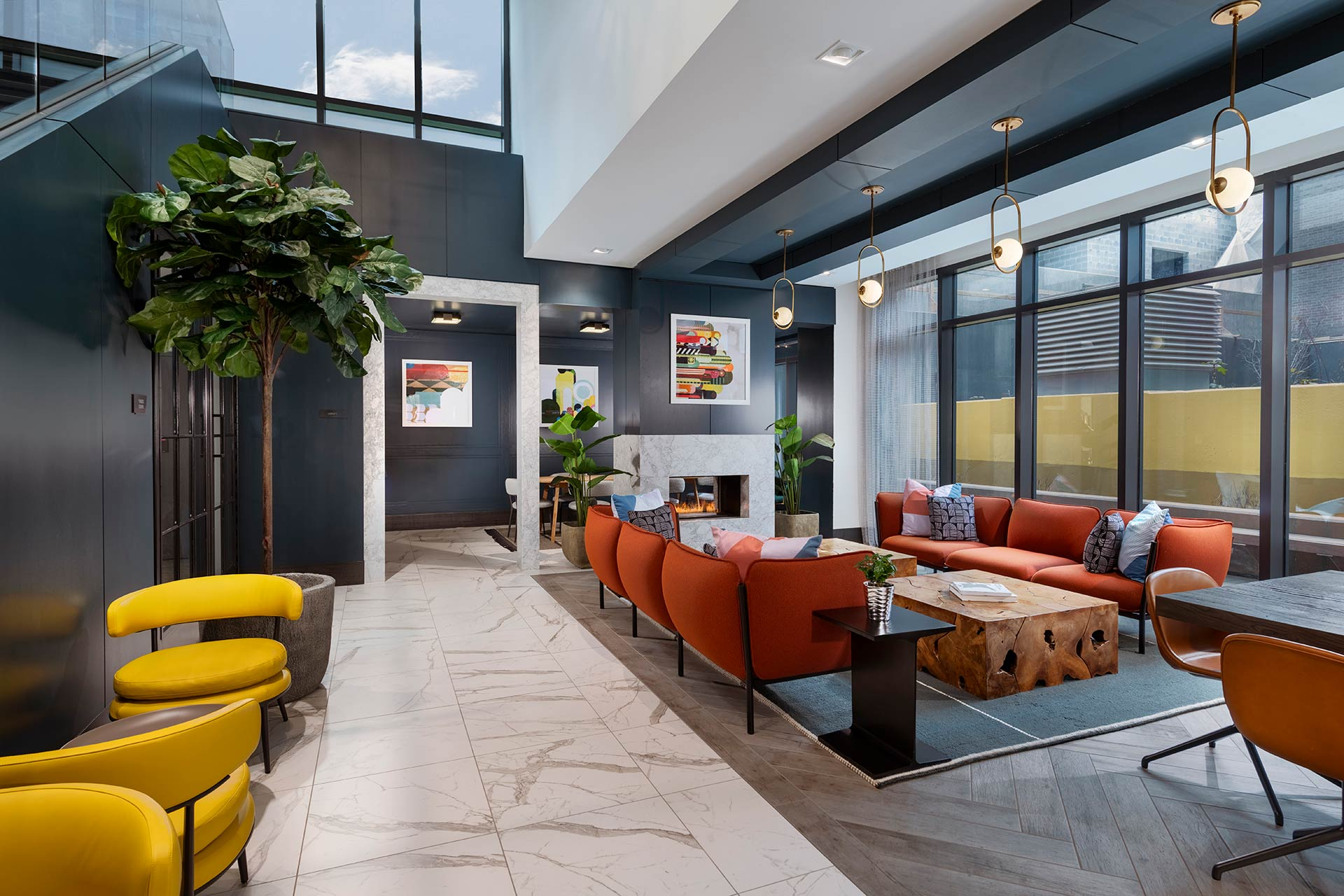 lobby lounge with sofas and gas fireplace