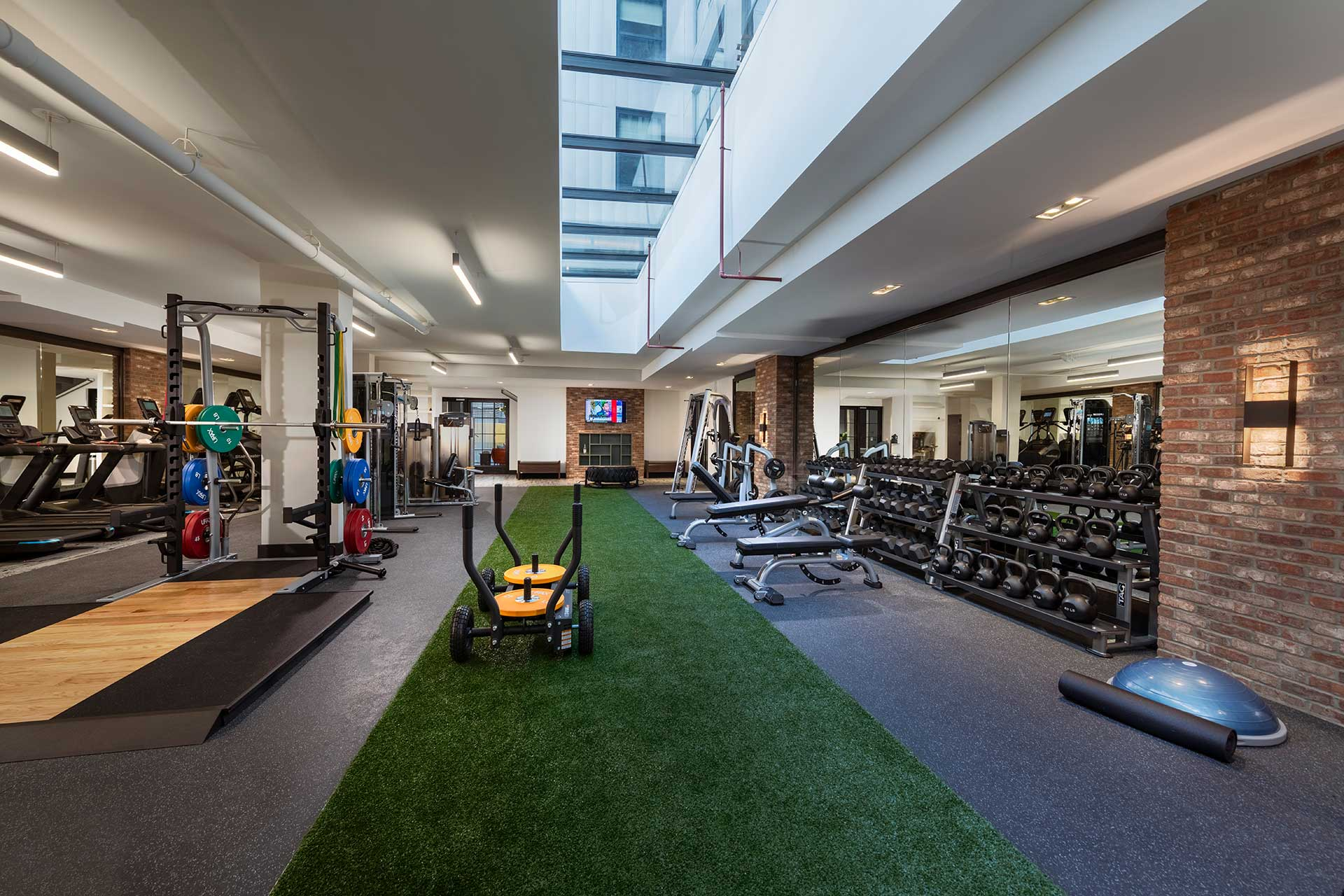 gym with free weights and turf flooring