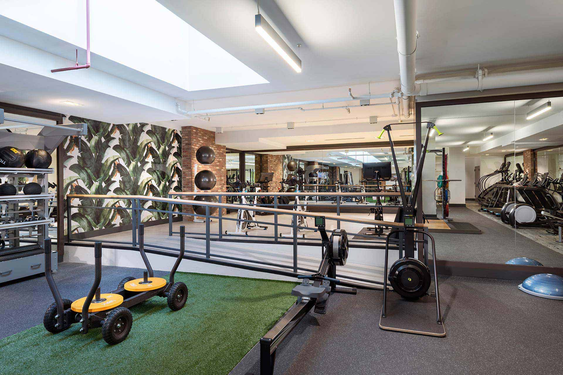 gym with yoga and spin studio area