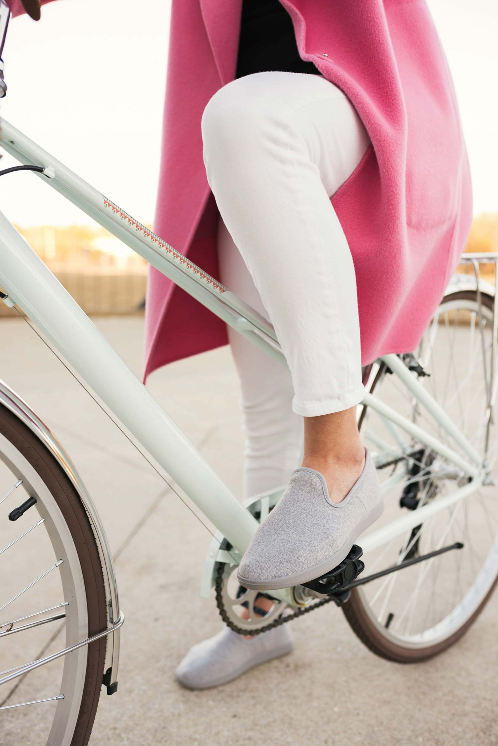 woman on white bicycle