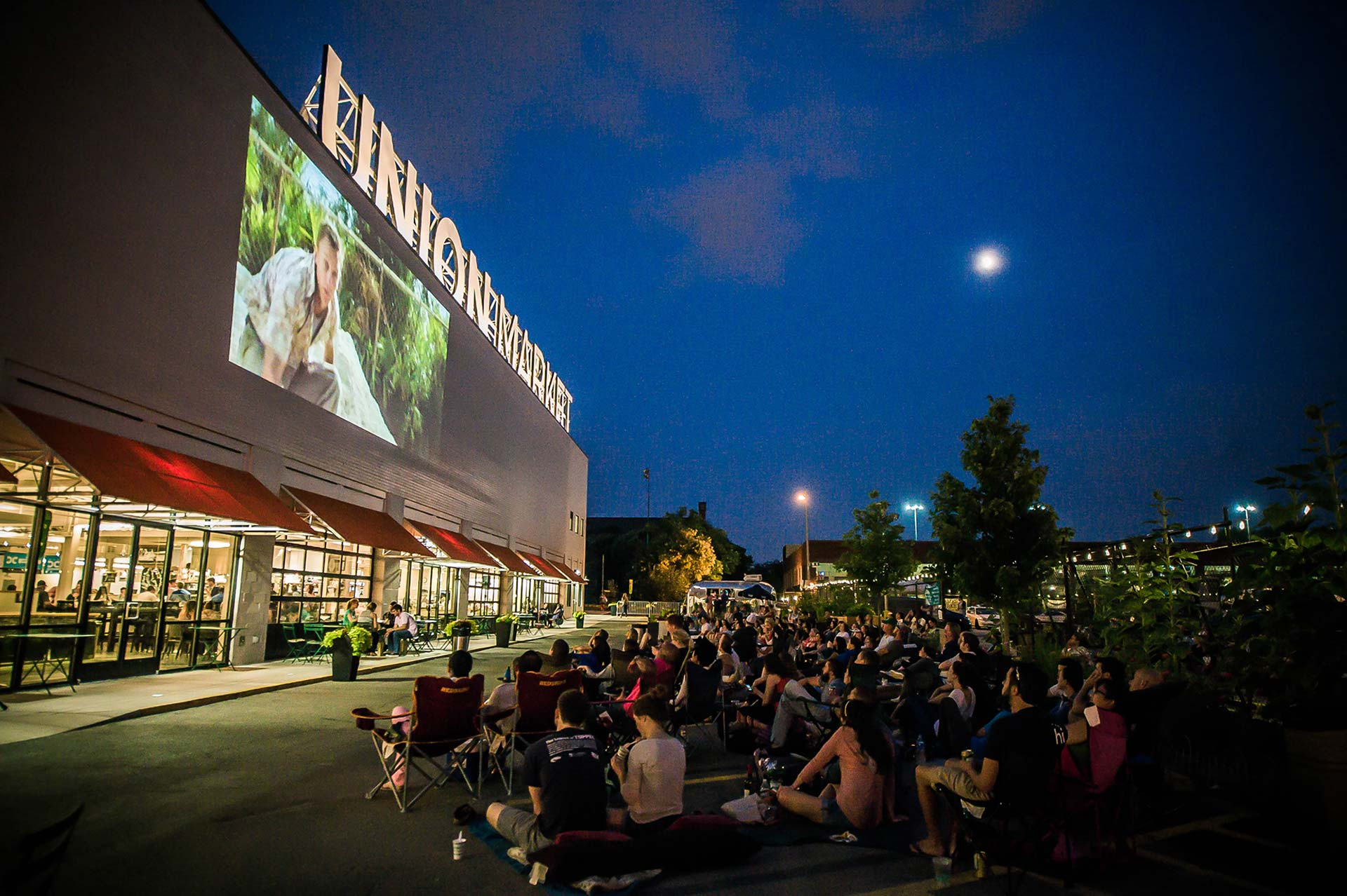 crowd watching outdoor movie at union market